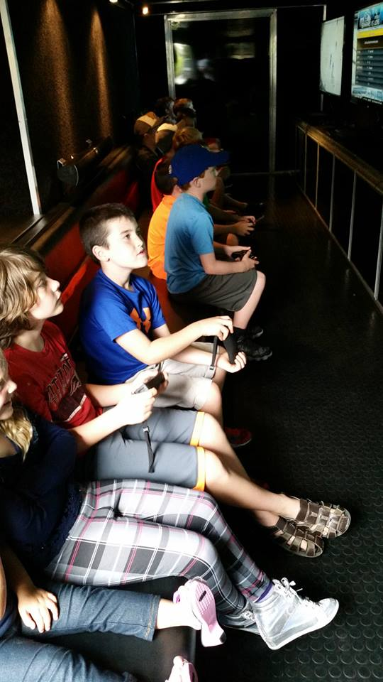 kids-inside-ultimate-mobile-gaming-truck-boston